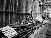 13 JULY 2017 - BANGKOK, THAILAND: Construction materials ready to recycled in Pom Mahakan. Most of the residents in the 150 year old slum community have been evicted and their homes torn down. The reusable construction materials from the homes will be recycled.      PHOTO BY JACK KURTZ