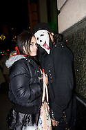 Girl with a man wearing the Scream mask