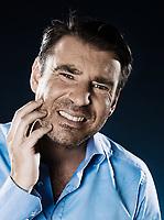 caucasian man  unshaven toothache portrait isolated studio on black background
