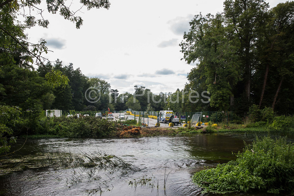 A large alder tree stump is seen alongside the river Colne on 29th July 2020 in Denham, United Kingdom. Only the stump remains from an ancient alder tree felled on 24th July as part of works for the HS2 high-speed rail link despite protests by environmental activists from HS2 Rebellion.
