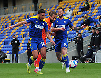 Football - 2020 /2021 Sky Bet League One - AFC Wimbledon vs Portsmouth - Plough Lane<br /> <br /> Ollie Palmer (9) and Nesta Guinness - Walker of Wimbledon  take on Marcus Harness of Portsmouth<br /> <br /> Credit : COLORSPORT/ANDREW COWIE