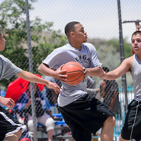 062114       Cable Hoover<br /> <br /> Lionel Money, center, rushes past Vincent Chata, right, and Jeremy Bill during a 3-on-3 basketball tournament at Ford Canyon Park in Gallup Saturday.