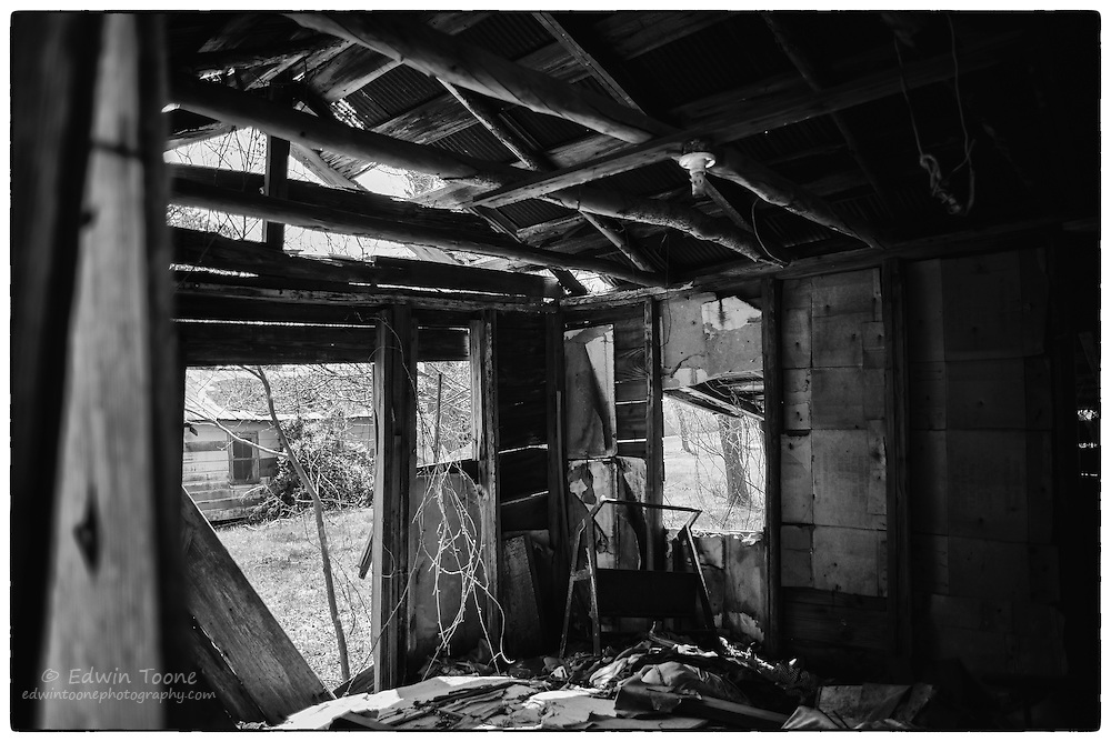 Looking through the ruins of an old destroyed work shed.
