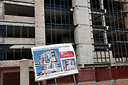 Rwanda -Kigali. Sign for  new office construction in front of half completed building. Rwanda is currently undergoing a building boom.