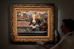 "© Licensed to London News Pictures. 19/06/2015. London, UK. A Sotheby's staff member shows Edouard Manet's ""Le Bar aux Folies-Bergère"" (est. £15-£20m), at Sotheby's Impressionist, Modern & Contemporary Art preview, ahead of the sale on 24 June 2015. Leading the sale are Kazimir Malevich's, ""Suprematism, 18th Construction"" and Edouard Manet's ""Le Bar aux Folies-Bergère"".  Photo credit : Stephen Chung/LNP"