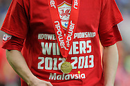 a close up view of Cardiff city player Craig Noone with his championship medal.   NPower championship, Cardiff city v Bolton Wanderers at the Cardiff city Stadium in Cardiff, South Wales on Saturday 27th April 2013. pic by Andrew Orchard,  Andrew Orchard sports photography,