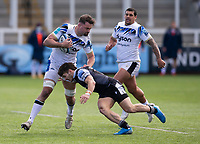 Rugby Union - 2020 / 2021 Gallagher Premiership - Round 13 - Newcastle Falcons vs Bath - Kingston Park<br /> <br /> Elliott Stooke of Bath is tackled by Mateo Carreras of Newcastle Falcons<br /> <br /> Credit : COLORSPORT/BRUCE WHITE