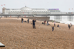 © Licensed to London News Pictures. 08/06/2019. Brighton, UK. Only a handful of people can be seen on the beach as rough seas and strong winds hit the Brighton and Hove seafront on Saturday morning in the aftermath of storm Miguel. Photo credit: Hugo Michiels/LNP