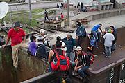 """A crowd of central american migrants boards in the train, nicknamed """"La Bestia"""". (Photo: Prometeo Lucero)"""