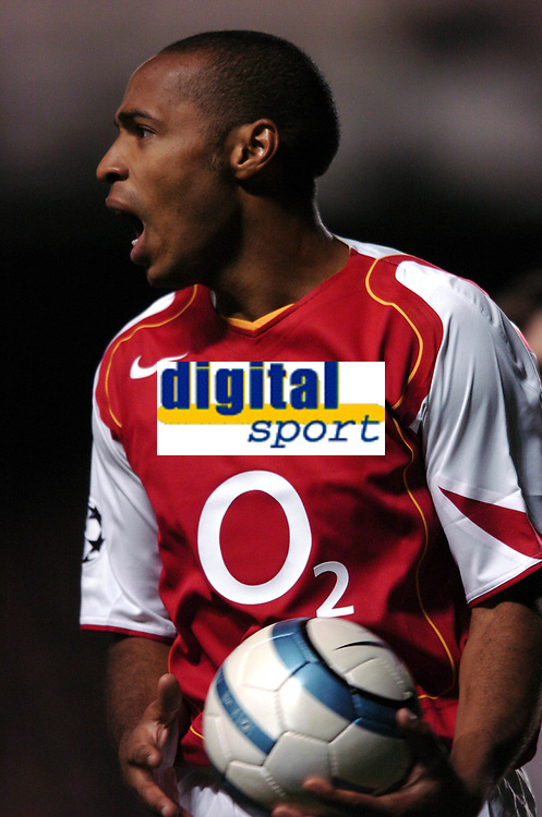 Thierry Henry moans at linesman<br />Arsenal 2004/05<br />Arsenal V PSV Eindhoven 14/09/04<br />UEFA Champions League<br />Photo Robin Parker Fotosports International