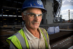 Park staff portrait. Concrete worker Paddy Shine at work in the Olympic Stadium. Picture taken on 10 Jul 09 by David Poultney.