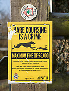 Hare coursing is a crime NFU, National Farmers Union notice, Wiltshire, England, UK