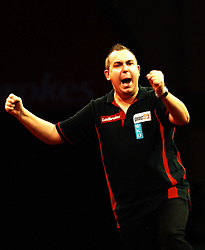 Belgium's Kim Huybrechts celebrates his win over  England's James Richardson  in the Darts World Championships at Alexandra Palace, London, Tuesday, Dec.. 27, 2011. photo by Morn/I-Images