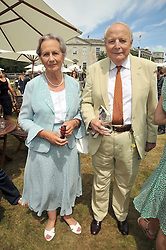 The DUKE & DUCHESS OF RICHMOND & GORDON at a luncheon hosted by Cartier for their sponsorship of the Style et Luxe part of the Goodwood Festival of Speed at Goodwood House, West Sussex on 5th July 2009.