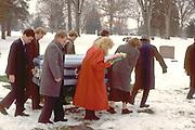 Grandchildren pallbearers carrying grandmother to grave. St Paul Minnesota USA