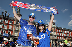 Leicester City fans pose for a photograph with their half and half scarf in Plaza Mayor ahead of the game