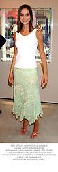 MISS OCTAVIA KHASHOGGI at a party in London on 7th May 2003.PJJ 34