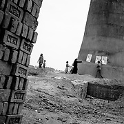 A block mobilization coordinator (BMC) supervising the display of IEC (Information, education and communication) material at a brick kiln outside of Patna, Bihar.