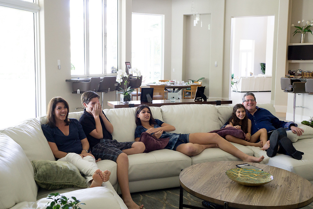 MAY 23, 2015---BOCA RATON, FLORIDA----<br /> The Zietz family sits around watching the show Shark Tank in the Boca Raton house. From left; Rachel, Jordan, 13, Rachel, 14, Morgan, 9 and Sam. Parents Sam and Rachel have instilled in their children the entrepreneurial spirit and it has paid off. Older children Rachel, 14, and her brother Jordan, 13, each has their own business and they're thriving.