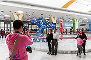 Passengers have their pictures taken at the Disney subway station in Shanghai, China, on Saturday, May 7, 2016. The $5.5 billion Shanghai Disneyland is one  of the most profitable Disney ventures in the world and the first theme park on mainland China.