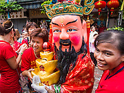 """19 FEBRUARY 2015 - BANGKOK, THAILAND:  Chinese deities solicit donations during a Chinese New Year parade on Yaowarat Road in Bangkok. 2015 is the Year of Goat in the Chinese zodiac. The Goat is the eighth sign in Chinese astrology and """"8"""" is considered to be a lucky number. It symbolizes wisdom, fortune and prosperity. Ethnic Chinese make up nearly 15% of the Thai population. Chinese New Year (also called Tet or Lunar New Year) is widely celebrated in Thailand, especially in urban areas that have large Chinese populations.   PHOTO BY JACK KURTZ"""