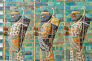 Coloured glazed terracotta brick panels depicting Achaemenid Persian royal bodyguards or archers. From the reign of Darius 1st and the First Persian or Achaemenid Empire around 510 BC excavated from the Palace of Darius 1st. Susa was one of the residential cities of the Achaemenid Kings. The Palaces are noteworthy for their elaborate decorations which can be considered exemplary of art at a royal court. The walls of Darius's palace at Susa were embellished with colourful reliefs made from glazed bricks on the Babylonian model. It is not certain which rooms of the palace was decorated with representations of a procession of royal bodyguards or archers, dressed in richly decorative costumes.  The Vorderasiatisches Museum, part of the Pergamon Museum, Berlin .<br /> <br /> If you prefer to buy from our ALAMY PHOTO LIBRARY  Collection visit : https://www.alamy.com/portfolio/paul-williams-funkystock/persian-antiquities.html  <br /> <br /> Visit our ANCIENT WORLD PHOTO COLLECTIONS for more photos to download or buy as wall art prints https://funkystock.photoshelter.com/gallery-collection/Ancient-World-Art-Antiquities-Historic-Sites-Pictures-Images-of/C00006u26yqSkDOM