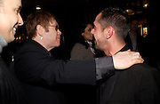 Sir Elton John and  Shaun Leane. Party hosted by Isabella Blow in honour of Shaun Leane to celebrate his jewelry collection. Liberty's. London. 8 December 2004. ONE TIME USE ONLY - DO NOT ARCHIVE  © Copyright Photograph by Dafydd Jones 66 Stockwell Park Rd. London SW9 0DA Tel 020 7733 0108 www.dafjones.com