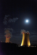 full moon over atomic power plant cooling towers