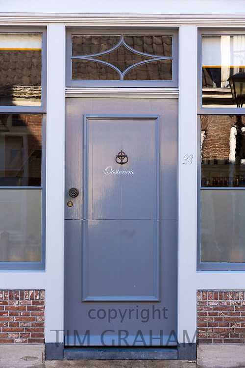 Quaint traditional wooden grey front door entrance doorway in the town of Edam, The Netherlands