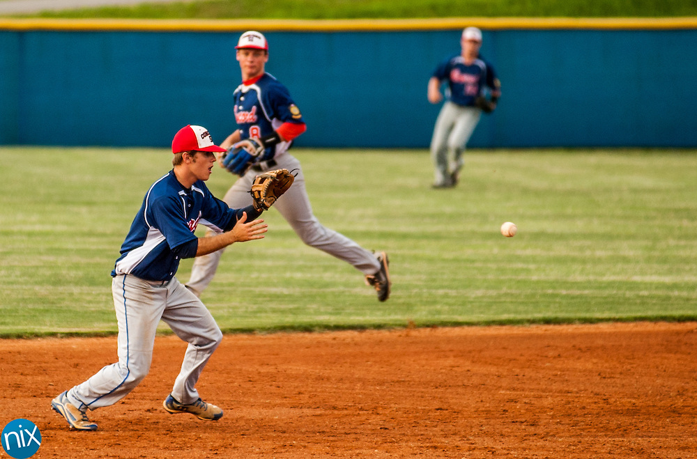 Concord Post 51's Brett Barrier fields an infield hit against Mooresville Post 66 Monday night at Lake Norman High School. Concord won the game 6-5.