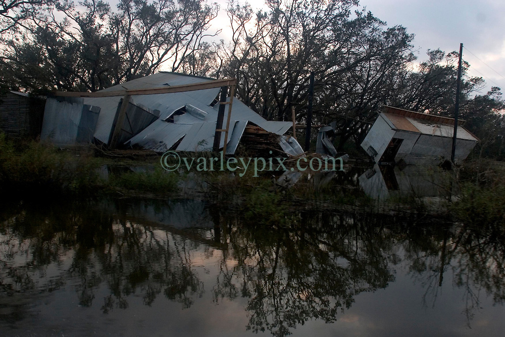 25 Sept, 2005.  Carlyss, Louisiana. Hurricane Rita aftermath. <br /> The destroyed remains of a bayou home one day after the storm ravaged the area.<br /> Photo; ©Charlie Varley/varleypix.com