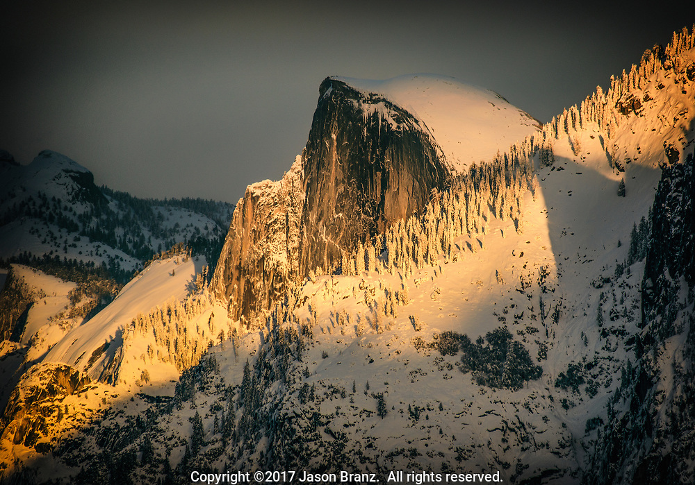 Sunset light on Half Dome after a winter snow, Yosemite National Park, California.
