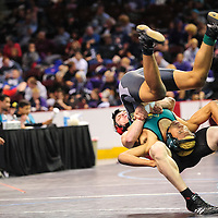 022114  Adron Gardner/Independent<br /> <br /> Grants Pirate Tristan Williamson flips Los Alamos Hilltopper Aaron Hinojos in the third place bracket during the state wrestling championship at the Santa Ana Star Center in Rio Rancho Friday.