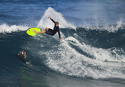 December 16, 2017 - Banzai Pipeline, HI, USA - BANZAI PIPELINE, HI - DECEMBER 16, 2017 - John John Florence of Hawaii makes a turn right above a water photographer while free surfing Off The Wall before the start of the Billabong Pipe Masters Saturday. (Credit Image: © Erich Schlegel via ZUMA Wire)