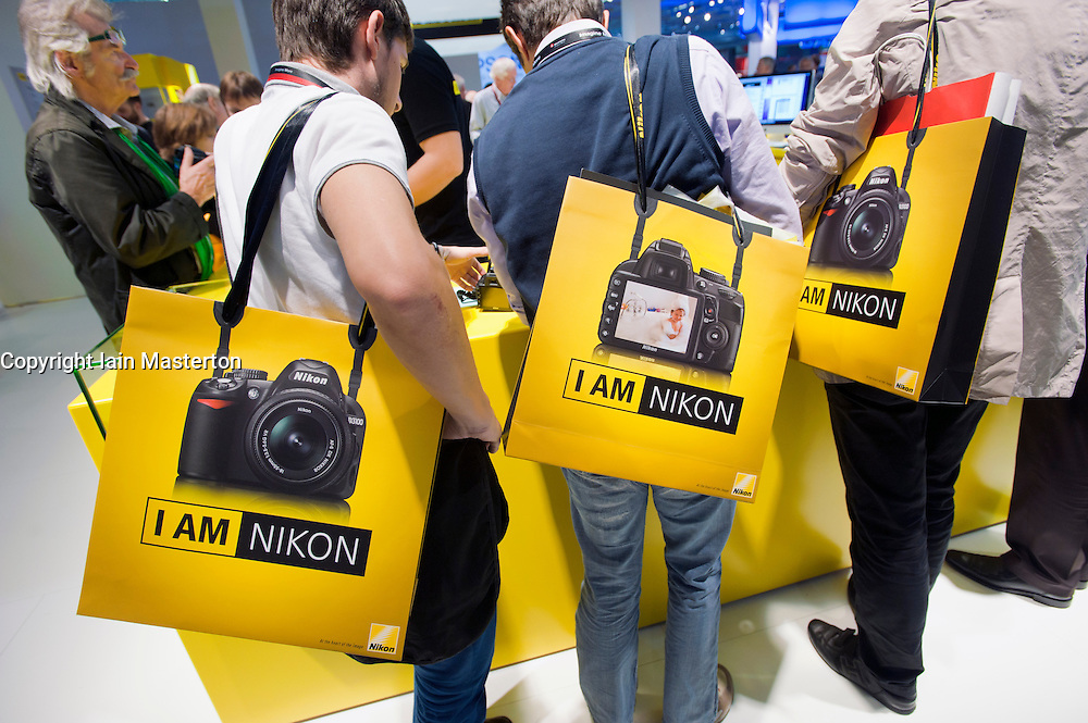 Many people at Nikon stand at Photokina digital imaging trade show in Cologne Germany 2010