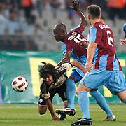 Trabzonspor's Deguy Alain Didier ZOKORA (C) during their UEFA Champions League third qualifying round, second leg, soccer match Trabzonspor between Benfica at the Ataturk Olimpiyat Stadium at ›stanbul Turkey on Wednesday, 03 August 2011. Photo by TURKPIX