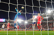 Laura O'Sullivan (1) of Wales punches a cross away during the FIFA Women's World Cup UEFA Qualifier match between England Ladies and Wales Women at the St Mary's Stadium, Southampton, England on 6 April 2018. Picture by Graham Hunt.
