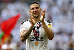 Fulham's Aleksandar Mitrovic celebrates winning promotion after the final whistle during the Sky Bet Championship Final at Wembley Stadium