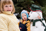 family at the snow in the Sierra Nevadas near Shaver Lake during Winter with Snowman