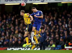 Branislav Ivanovic of Chelsea wins a header against Kevin van Veen of Scunthorpe United - Mandatory byline: Robbie Stephenson/JMP - 10/01/2016 - FOOTBALL - Stamford Bridge - London, England - Chelsea v Scunthrope United - FA Cup Third Round