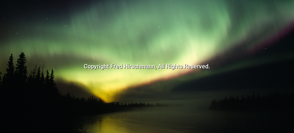 Aurora over the Tanana River, geomagnetic storm during early morning hours of September 15, 2005, Tanacross, Alaska.