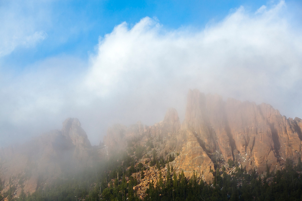 Granite rock spires shrouded by clouds above McMurdy Park, Lost Creek Wilderness, Colorado.