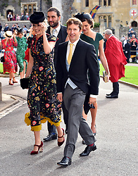 Sofia Wellesley and James Blunt arrive for the wedding of Princess Eugenie to Jack Brooksbank at St George's Chapel in Windsor Castle.