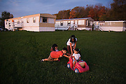 Children play together outside their homes at Hudson Valley Foie Gras in Ferndale, New York on October 11, 2008. Some of the workers and their families, practically all Mexican immigrants, live on the grounds of the factory in company provided housing; a small, isolated Mexican community flourishes in the Catskills.