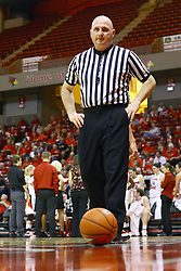15 March 2012:  Referee Jeff Cross walks to pick up an idle ball during a first round WNIT basketball game between the Central Michigan Chippewas and the Illinois Sate Redbirds at Redbird Arena in Normal IL
