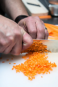 Cheff slices and dices a carrot