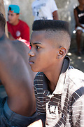 Boy young Brazilian man just had his hair cut into a street style portrait. Young independent barber shop hair stylist in the street for the young people guys of Vila Valquiere, West Zone Zona Oueste, Rio de Janeiro