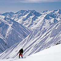 A ski mountaineer crosses Gulol Pass, en route across the Himalaya.