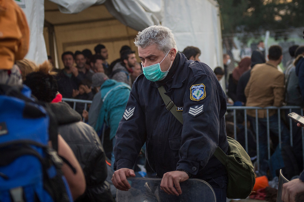 March 5, 2016 - Idomeni, Greece:  Greek Police man  at the  Idomeni border crossing. 12,000 refugees are stuck here after Macedonia closed the border. New arrivals come in every day, making living conditions more and more difficult. (Steven Wassenaar/Polaris)
