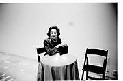Nadia Juglm sitting at a table. Geoffrey Beene Awards show, 1988© Copyright Photograph by Dafydd Jones 66 Stockwell Park Rd. London SW9 0DA Tel 020 7733 0108 www.dafjones.com